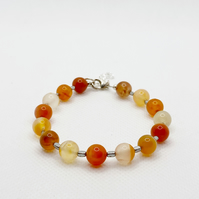 Carnelian and hematite adjustable bracelet with a sterling silver clasp