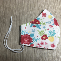 Pretty floral design on white background face mask to fit an adult.