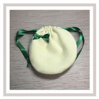 Yellow Circular Bag with eco friendly wipes