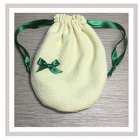 Yellow Oval  Bag with eco friendly wipes