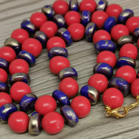 Eye catching orange and blue handmade beaded necklace with gold shimmer
