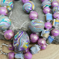 Striking marble effect handmade necklace. Handmade multi-coloured beads