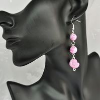 Beaded dangle earrings. Soft mauve, salmon pink swirl stripe. Handmade.