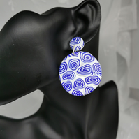 Attention grabbing disc earrings, blue and white swirl  design. Drop earrings.