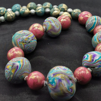 Statement, handmade, bead necklace with multicoloured, marbled focal beads.