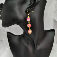 Stylish, beaded drop earrings. Blue, white, pink, swirly stripes. Handmade beads