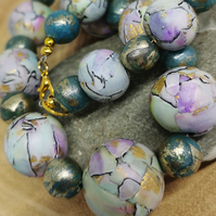 Cracked glaze effect statement necklace in aquatic tones