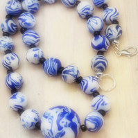 Blue and white patterned bead choker necklace