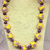 Unique chunky, handmade, beaded statement necklace with rose motive
