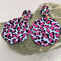 Vivid leopard print earrings, blue and pink. Large, round statement earrings.