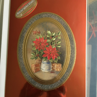 Traditional Red Poinsetta on Shiny Red Card