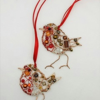 Two Robin decorations