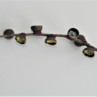Natural oak tree twig with blue and yellow floral painted acorn caps