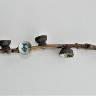 Natural oak tree twig with blue fish painted acorn caps