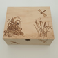 Decorative wooden keepsake or storage box with frog and dragonflies design
