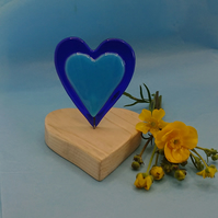 Blue, fused glass heart mounted on heart shaped, wooden base