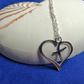 Heart shaped open cross pendant
