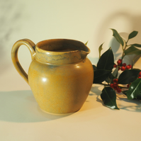 Hand made ceramic pint jug in matt brown