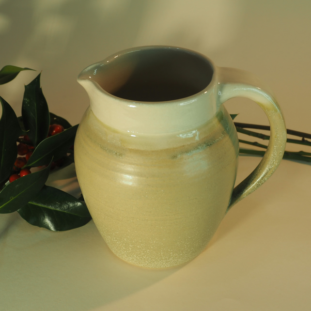 Wheel thrown ceramic jug, traditional shape, light green