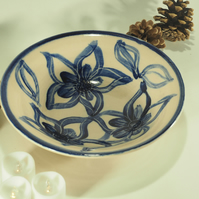 Ceramic hand-painted bowl with blue and white flower design