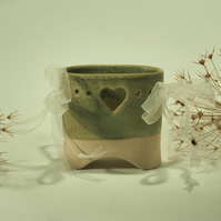 Ceramic oval bridge vase with heart cut-out and ribbons