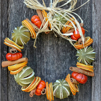 Citrus fruit and spice ring wreath scented with natural orange and cinnamon oil