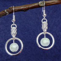 Chainmail earrings with a misty pearl bead in a hoop