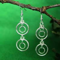 Silver plated earrings. Rings within rings