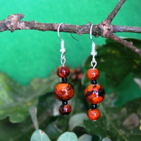 Burnt orange and black marled triple bead earrings