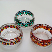 Clear glass bowls hand painted in various colours, set of 3.