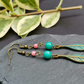 Brass feather boho earring with turquoise and coral beads