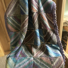 Hand knitted multicoloured baby cot blanket or lap cover