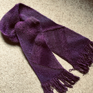 Shades of purple, hand knitted scarf.