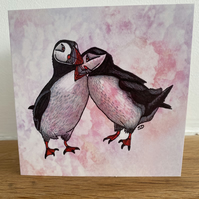 Puffins card with pink clouds