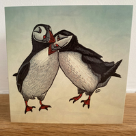 Puffins card with green sky