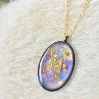 Galaxy N Oval pendant on gold chain
