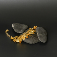 Gold Leaves and shells bracelet.