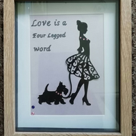 Handmade framed paper cut art featuring a lady with a scottie dog