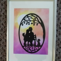 Handpainted and paper cut framed silhouette of a couple and a dog at Sunset
