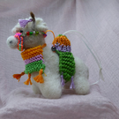 Needle felted Alpaca dressed in bright colours.