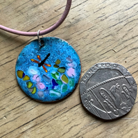 Blue enamelled copper round dragonfly pendant on pink leather cord
