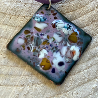 Pink enamelled copper square pendant on purple leather cord