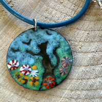 Round enamelled copper black cat with flowers pendant on blue leather cord
