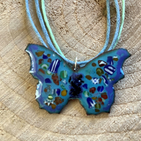 Blue enamelled copper butterfly pendant on cotton cord with 925 silver clasp