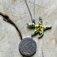 Yellow enamelled copper starfish pendant on 925 silver curb chain