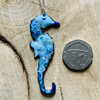 Blue enamelled copper seahorse pendant on 925 silver curb chain