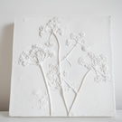 White floral plaster plaque