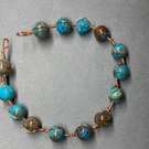 Bead bracelet with a copper wire wrap