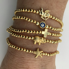 24KT GOLD-PLATED STRETCH STACKING BRACELET WITH CHARM