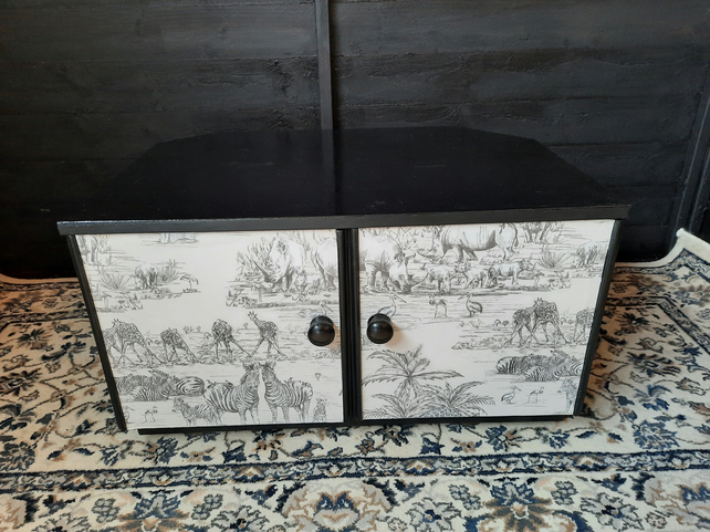 Upcycled t.v cabinet with decoupage detail to the doors.